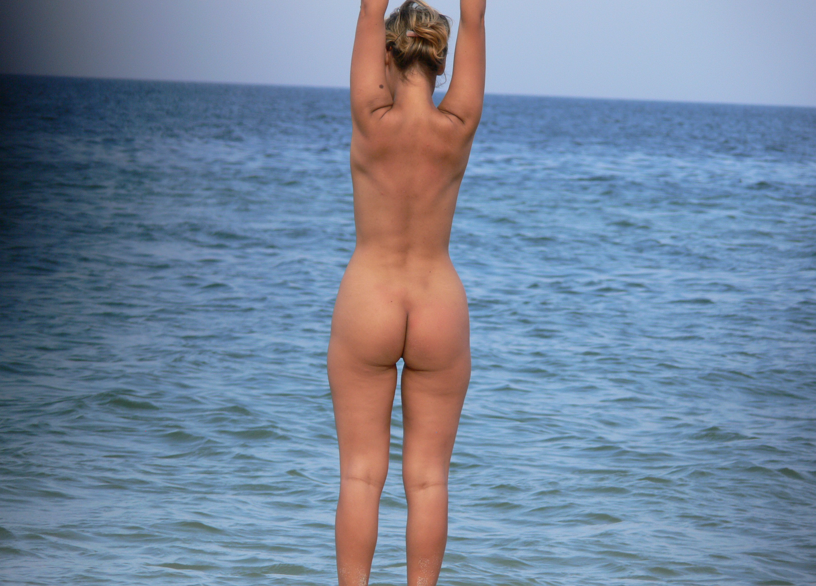 Teen nudists on beach