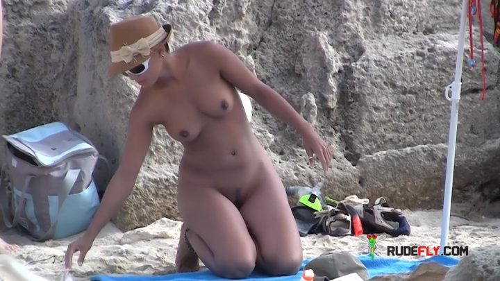Gal relaxing on nude plage