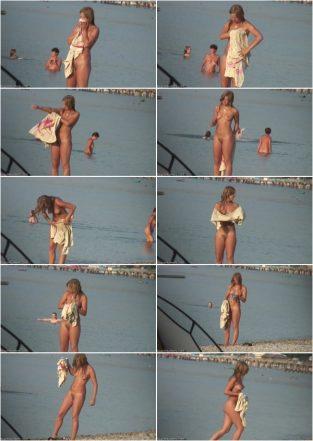 Pretty girl nude on the beach